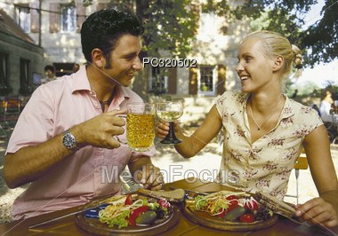 Couple Dining Outdoors Stock Photo