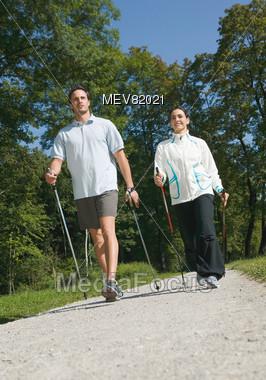 Couple Doing Nordic Walking Exercise Stock Photo