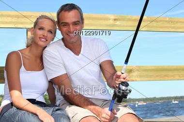 Couple Doing Sea Fishing Stock Photo