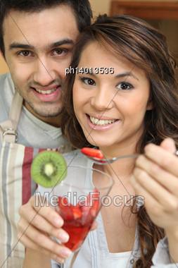 Couple Eating Fruit Salad Stock Photo