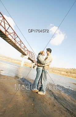 Couple Embrace In River Valley Stock Photo