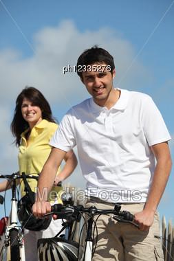 Couple Enjoying A Bike Ride Together Stock Photo