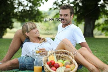 Couple Enjoying Picnic Stock Photo