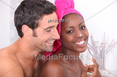 Couple Getting Ready In Bathroom Stock Photo