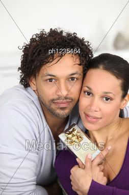 Couple Gift Giving Stock Photo