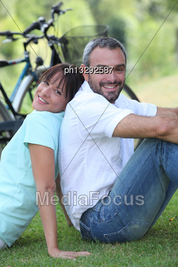 Couple Having A Bike Ride In The Country Stock Photo