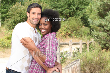 Couple Having A Cuddle In The Countryside Stock Photo