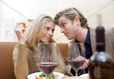 Couple Having Dinner at Restaurant Stock Photo
