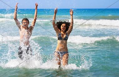 Couple Having Fun In The Sea Stock Photo