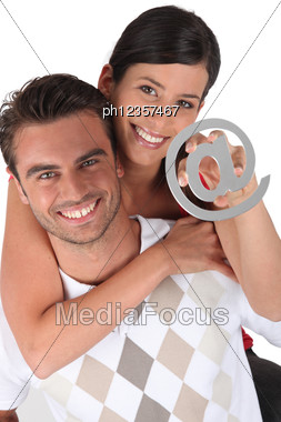 Couple Holding At Symbol Stock Photo