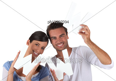 Couple Holding The Letters WWW Stock Photo