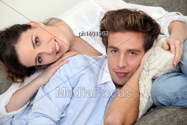 Couple Hugging On A Sofa Stock Photo
