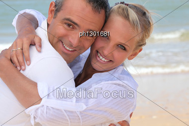 Couple Hugging On The Beach Stock Photo