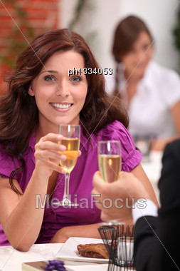 Couple In A Restaurant Drinking Champagne Stock Photo