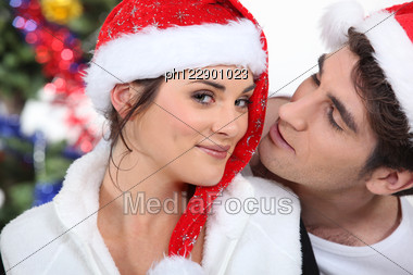Couple In Christmas Stock Photo