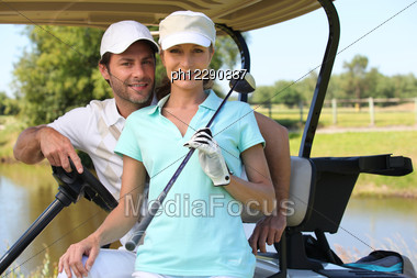 Couple In Golf Car Stock Photo