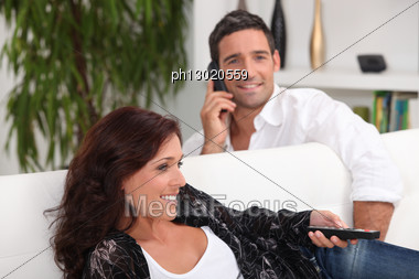 Couple In Living Room Stock Photo