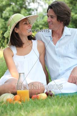 Couple In Park Having Picnic Stock Photo
