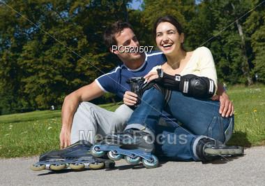 Couple Inline Skating Stock Photo