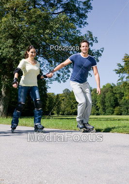Couple Inline Skating Stock Photo