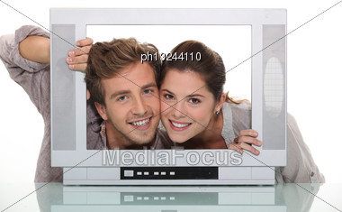 Couple Inside A Tv Screen Stock Photo