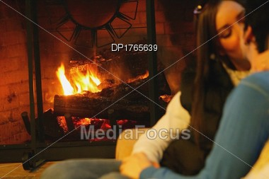Stock Photo Couple Kiss In Front Of Fireplace - Image DP1765639 ...