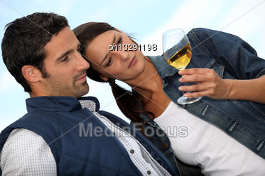 Couple Looking At A Glass Of Alcohol Stock Photo