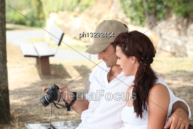 Couple Looking At Photos Stock Photo