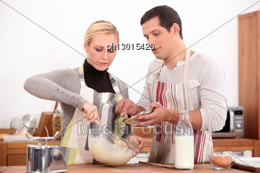Couple Making A Cake Together Stock Photo