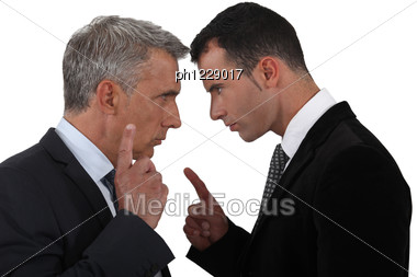 Couple Of Executives Discussing Stock Photo
