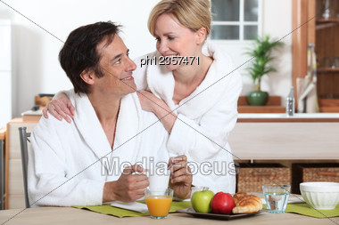 Couple Of Happy Fortysomethings Having Breakfast Stock Photo