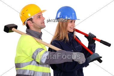 Couple Of Manual Workers Stock Photo