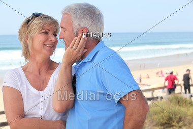 Couple On Beach Front Stock Photo