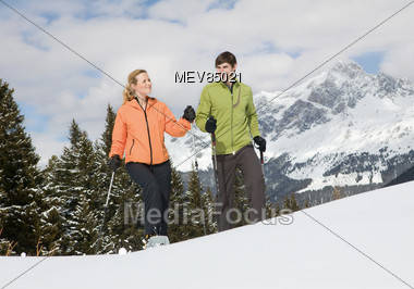 Couple On Snow Shoes Stock Photo