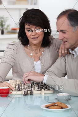 Couple Playing Chess Together Stock Photo