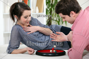 Couple Playing Dice Stock Photo