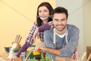 Couple Preparing A Meal Together Stock Photo