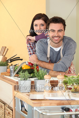 Couple Preparing Fresh Vegetables Stock Photo