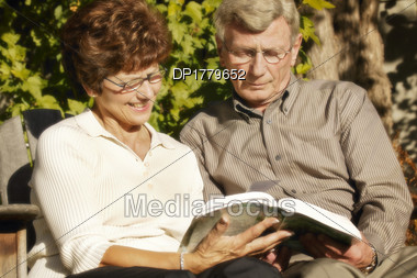 Couple Read Together Stock Photo