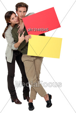 Couple With Red And Yellow Blank Cards Stock Photo