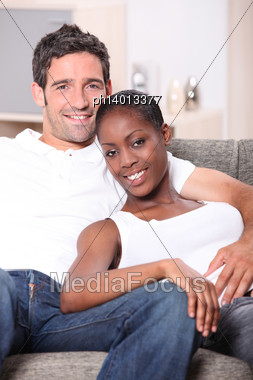 Couple Relaxing On A Couch Stock Photo