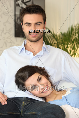 Couple Relaxing On The Couch Stock Photo