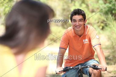 Couple Riding Bikes Stock Photo