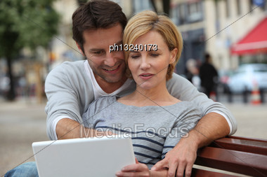 Couple Seated On A Bench Stock Photo
