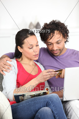 Couple Shopping On Internet Stock Photo
