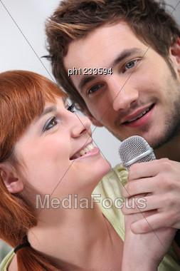 Couple Singing Karaoke Stock Photo