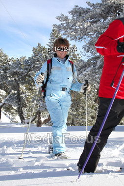 Couple Skiing In Forest Stock Photo