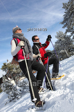 Couple Snow-shoeing Stock Photo