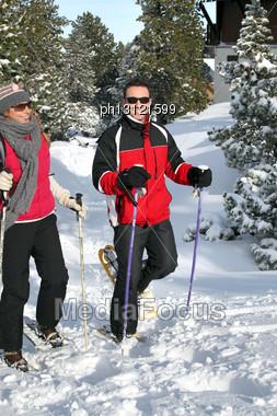 Couple Snowshoeing Stock Photo