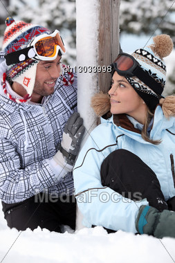 Couple Stood By Their Chalet Stock Photo
